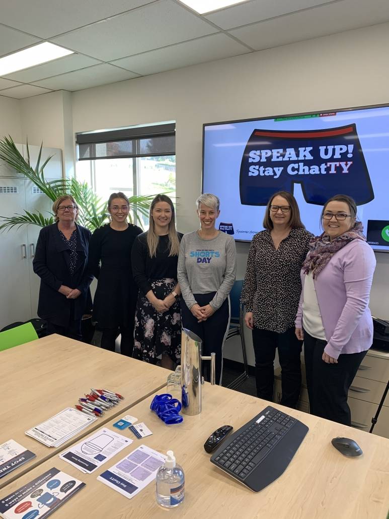 SPEAK UP! Stay ChatTY presenter gathered with Synectic community committee and staff
